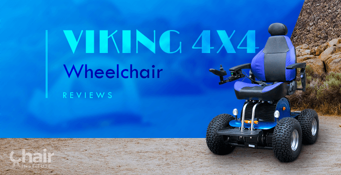 The Viking 4x4 Wheelchair on a Sandy terrain with a tent and boulders in the background