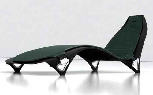 A sleek, green Aston Martin Lounge Chair