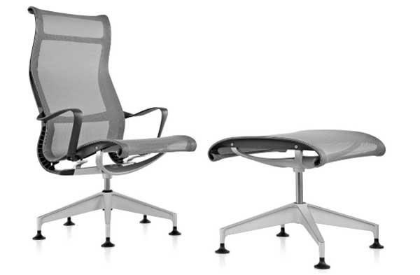 Setu Lounge Chair and Ottoman with mesh-like seat, backrest, and ottoman.