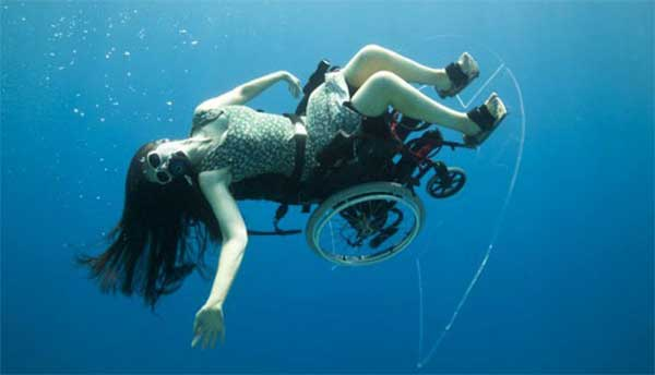 Image of Sue Austin underwater with her Submersible Wheelchair