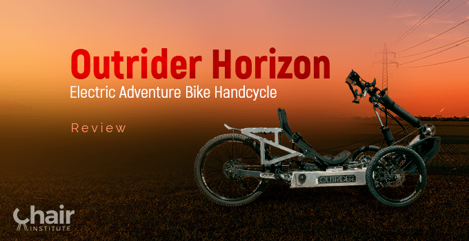 The Outrider Horizon Electric Adventure Bike Handcycle in a grassy outdoor with electric lines in the background